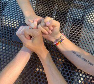 Hands linked together