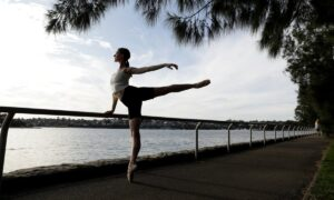 Woman in ballet pose near a body of water